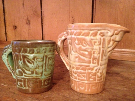 Frankoma's Mayan Revival cups in Prairie Green and Desert Gold glazes. Author's collection.